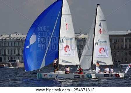ST. PETERSBURG, RUSSIA - AUGUST 3, 2018: Teams from Germany and Poland compete in Semifinal 2 of Sailing Champions League. 25 sailing teams participate in the competitions