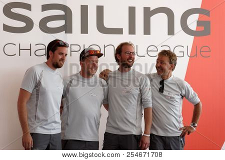 ST. PETERSBURG, RUSSIA - AUGUST 3, 2018: Athletes from Netherlands make group photo during Semifinal 2 of Sailing Champions League. 25 sailing teams take part in the competitions