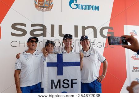 ST. PETERSBURG, RUSSIA - AUGUST 3, 2018: Athletes from Finland make group photo during Semifinal 2 of Sailing Champions League. 25 sailing teams take part in the competitions