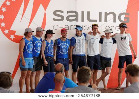 ST. PETERSBURG, RUSSIA - AUGUST 3, 2018: Athletes from Norway make group photo during Semifinal 2 of Sailing Champions League. 25 sailing teams take part in the competitions