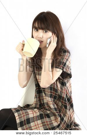 Young woman talking by mobile phone. Portrait of asian woman.