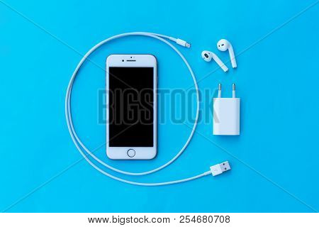 Rostov-on-don, Russia - April 28, 2018: Top View Plastic White Wireless Apple Airpods, Charging, Sma