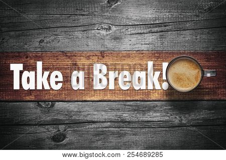 Take A Break! Text On Wooden Background With Coffee Cup, Top View.