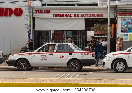 Tulum, Mexico - 7 August 2018: Ado Autobus Terminal With Tourists And Taxis.