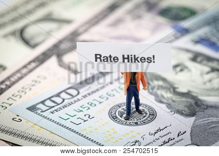 Fed Consider Interest Rate Hike, World Economics And Inflation Control, Miniature Man Holding Rate H