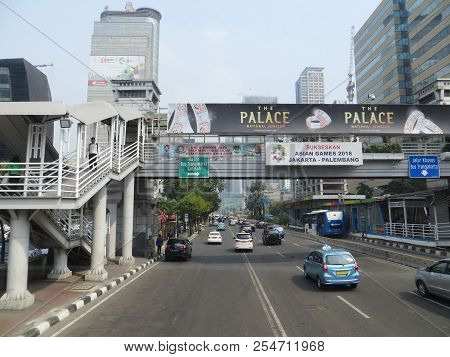 Jakarta, Indonesia - August 2, 2018: Pedestrian Bridge Connecting To Transjakarta Bus Shelter Sarina