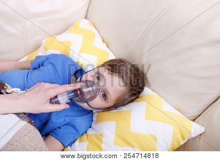 Boy Breathe Through Nebulizer. Sick Chid With Pediatric Nebulizer.