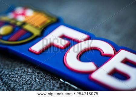 Khakiv, Ukraine - 02 May 2018: Logo of Football Club Barcelona close-up. Emblem of FC Barcelona on souvenir or magnet. Fan accessories