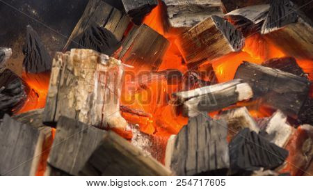 Glowing Hot Charcoal In Bbq Grill Pit With Flames, Close-up. Burning Coals Close Up.