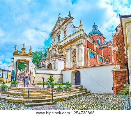 Krakow, Poland - June 11, 2018: The View On The Courtyard With Entrance Gates Of St Andrew Church Wi