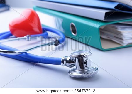 Books Folder File, Stethoscope, Red Heart And Rx Prescription Isolated On White Background.