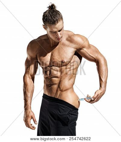 Bodybuilder Makes Injection Of Vitamins. Photo Of Sporty Man With Perfect Physique On White Backgrou
