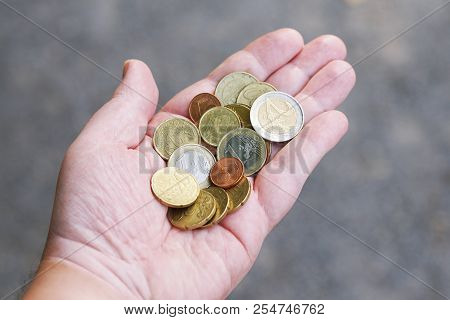 Handful Of Small Loose Pocket Change Euro Cent Coins In Palm Of Hand, Money Finance Currency Concept