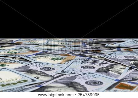 Stack Of One Hundred Dollar Bills Isolated On Black Background. Stack Of Cash Money In Hundred Dolla