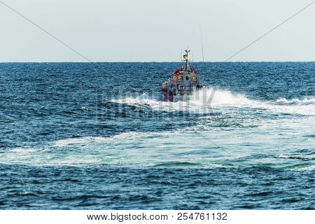 A Rescue Boat In The Sea Monitors The Safety Of Tourists On The Water And Stops Violators Of Order A