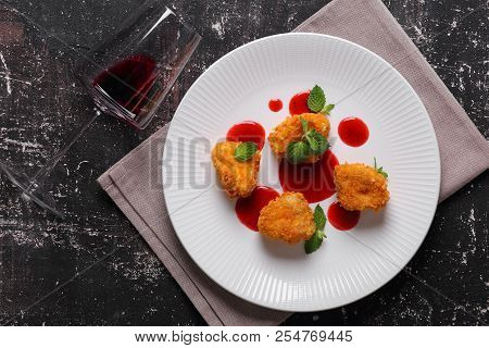 Camembert In Batter With Strawberry Sauce, Mint And Red Wine