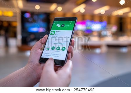 Chiang Mai, Thailand - August 03,2018: Woman Hands Holding Huawei With Wechat  On The Screen.wechat