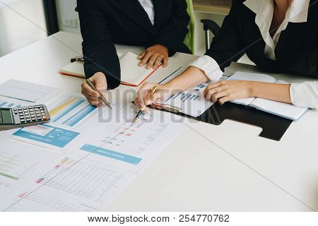 Businesswoman Hand Pen Pointing On Business Document At Meeting Discussion And Analysis Data The Cha