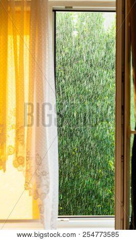Summer Rainy Outside Window, Water Drops Droplets Raindrops On Glass Windowpane. Downpour Rain.