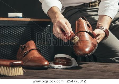 Man Applies Shoe Polish With A Small Brush