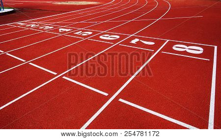 Treadmill With The Numbers Of The Sports Stadium. Track, Running, Red Sports Field In An Open-air Tr