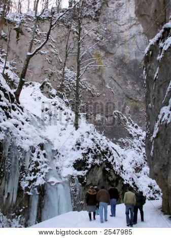 People Walking A Snow Covered Path
