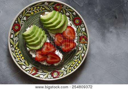 Bruschetta With Cream Cheese Avocado Strawberries And Chia Seeds