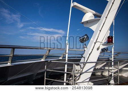 Boat Background. Deck Of A Large Boat On A Sunny Summer Day With Blue Sky And Blue Sea Horizon