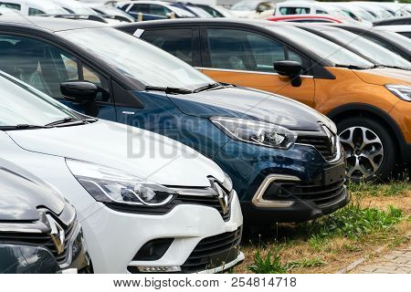 Prague, Czech Republic - August 15 2018: Renault Company Logo On Car In Front Of Dealership Building