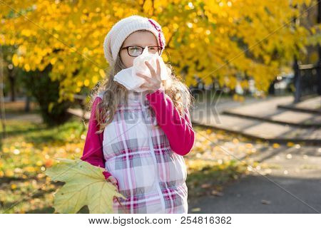 Autumn - Flu Season. Cute Young Girl Child In Glasses Sneezing In A Tissue Blowing His Runny Nose, B