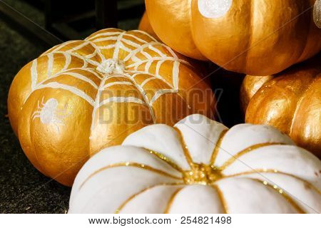 Beautiful Painted Pumpkins Of White And Gold Color On Halloween