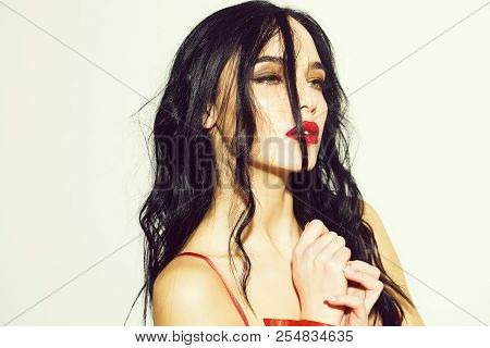 Pretty Woman Or Cute Sexy Girl In Erotic Bra With Long Curly Brunette Hair, Has Red Lips, Makeup On