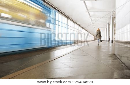 Metro station and rapid train on a platform