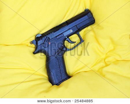 Gas gun on yelloq pillow