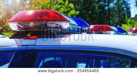 Patrol police car with beautiful emergency sirens lights. Canadian policemen in traffic control activity. A police raid for arrest and stop of crime delinquents. Flashing light on the cars of Rapid intervention crew in full mission. poster