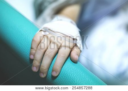 A Hand With Sick Child On A Receiving A Saline Solution In Hospital