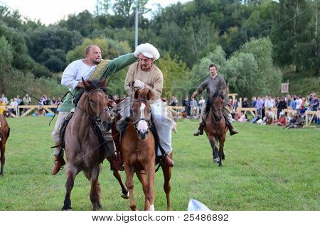 """MOSCOW - SEPTEMBER 4: Riders on horses. The international festival of fights """"Times and epoch"""". With over 130000 spectators on September 4, 2011 in Moscow, Russia."""