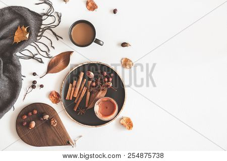 Autumn Cozy Composition. Cup Of Coffee, Plaid, Candle, Dried Leaves On White Background. Autumn, Fal