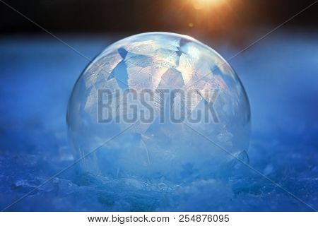 Frozen bubble with ice crystals in winter