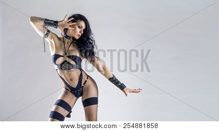 Sexy Brunette Dominatrix Posing At White Wall, Bdsm