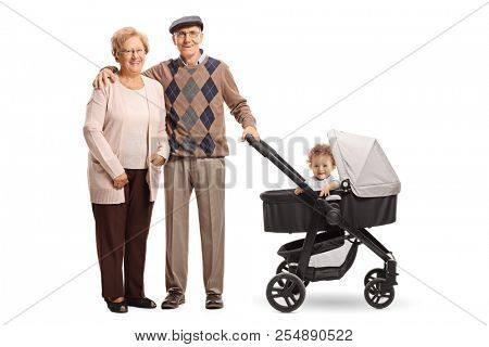 Happy grandparents standing with a pushchair and their grandson isolated on white background