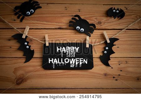 Halloween Crafts, Bat, Spide And Cobweb On Wooden Table Background With Happy Halloween Text. Hallow