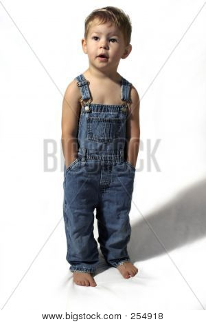 Boy In Overalls On White