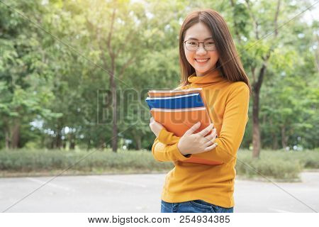 Summer Holidays, Education, Campus And Teenage Concept - Smiling Female Student In Black Eyeglasses