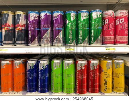 Alameda, Ca - March 06, 2018: Grocery Store Shelf With Cans Of Red Bull In Various Flavors. Red Bull