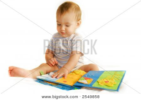 Baby Boy Reading A Book Over White