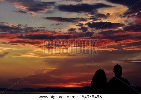 Honeymoon Romantic Couple In Love Walking On The Beach On Orange Sunset Background, Happy Young Coup