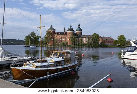 Mariefred, Sweden On May 12. View Of The Small Harbor, Boats And Gripsholm Castle On May 12, 2018 In