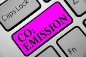 Writing note showing Co2 Emission. Business photo showcasing Releasing of greenhouse gases into the atmosphere over time Keyboard purple key Intention computer computing reflection document. poster