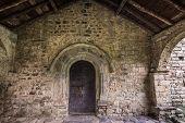 Ancient wooden door of Sant Feliu church in Barruera, Catalonia, Spain. poster